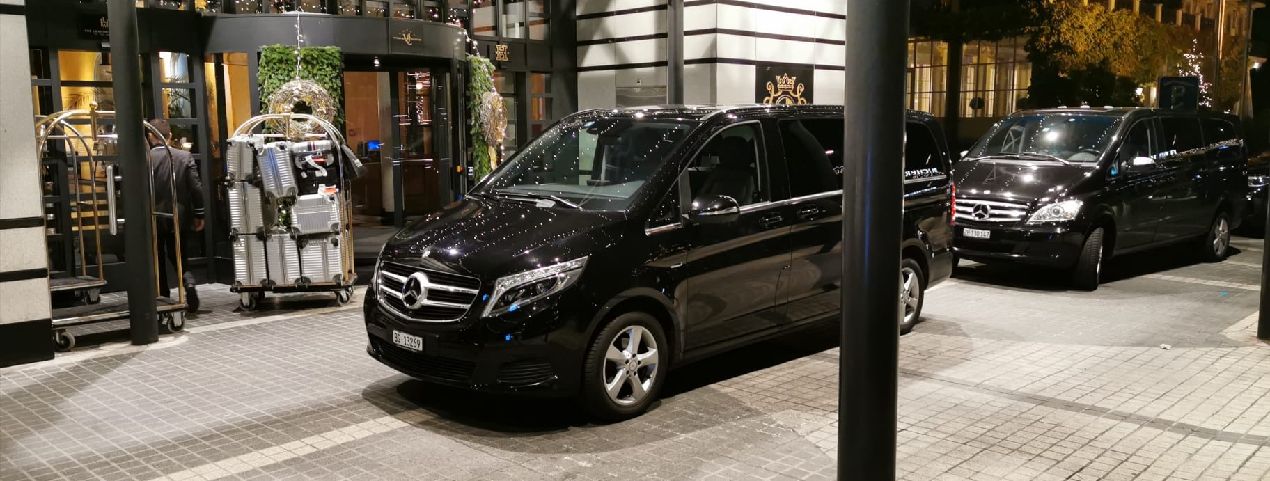 two mercedes vans in front of hotel zurich after basel airport transfer
